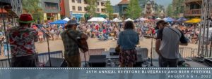 a bluegrass band plays on stage facing the crowd at Keystone Bluegrass & Beer Festival