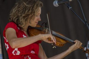 Woman playing violin at Keystone Bluegrass and Beer Festival during the summer