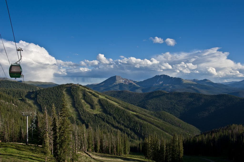 Summer picture of Keystone Colorado with the gondola in the foreground