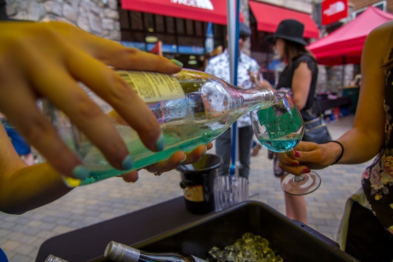 white wine being poured at festival in colorado