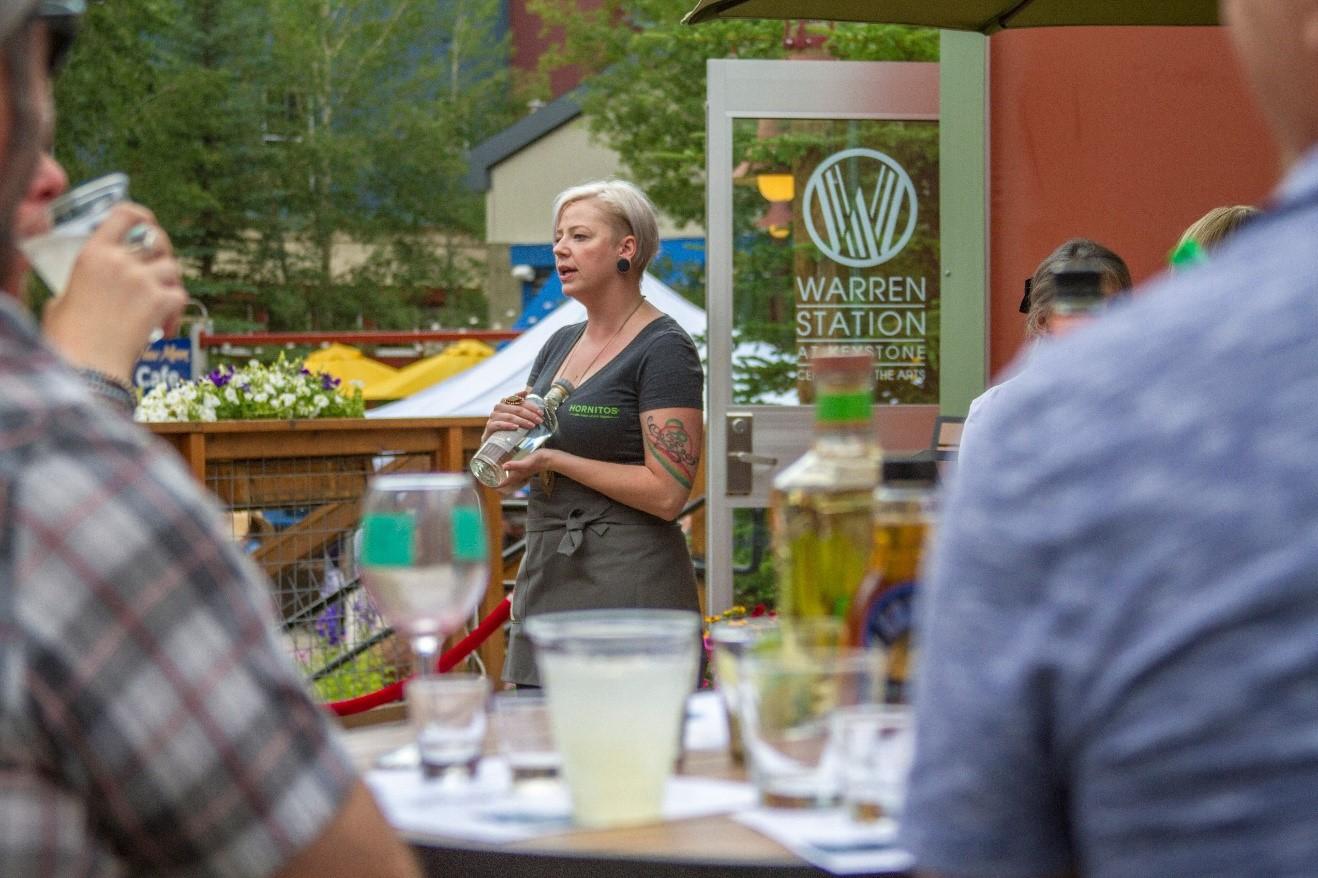 woman describing wine at wine seminar in keystone co